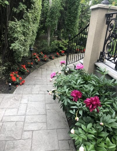 calgary gardening services gardener gardeners springbankgarden flowerbed maintenance stylish pixie gardens calgary gardeners gardening weeding weed plant planting service maintenance care team workers front yard roses bushes outside decoration with flowers
